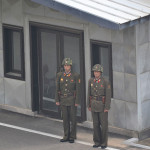 Soldiers standing guard at the DMZ, in North Korea.