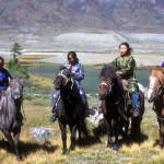 Group of Tuvan women on horseback.