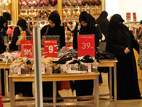 Group of Saudi women shopping at a high-end mall.
