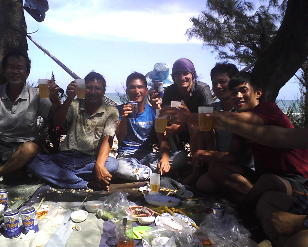 Toasting with locals in Central Vietnam.
