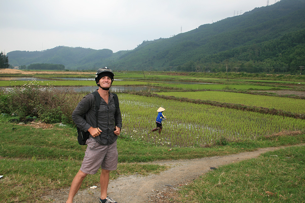 Standing in front of a rice paddy in rural Vietnam.