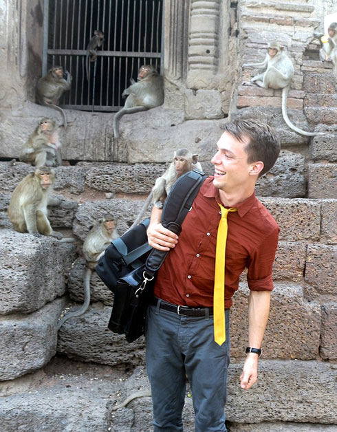 Gregory Diehl playing with monkeys.