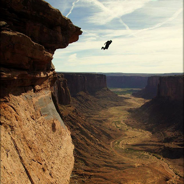 Mitch Potter jumping at Moab desert.