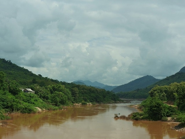 Gregoire Mevel crossing the Nam Ou river in Northern Laos.