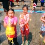 Children partaking in the Songkran festival in Thailand.