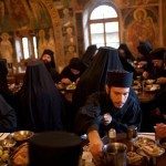 A group of monks at Mount Athos silently eating breakfast. The life of a monk is divided into 3 parts: prayer, rest, and work.