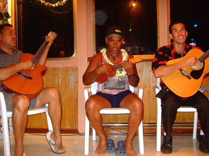 Crew entertaining guests aboard the Arunui III.