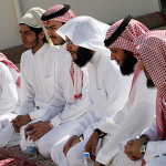 Saudi Arabian men at prayer.