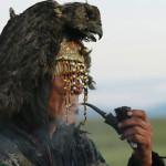 Tuvan shaman smokes a pipe.