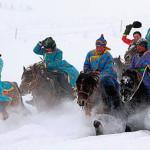 Tuvans riding horseback.