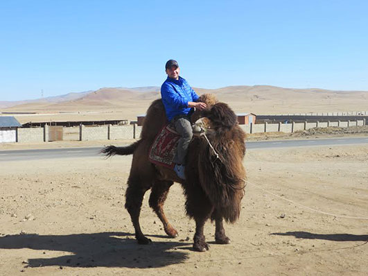 Ryan Trapp, jetsetting traveler, in Mongolia. Ryan earns 6-figures while only working a few weeks a year.
