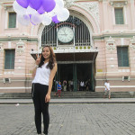 Girl with balloons outside of Saigon Post Office.