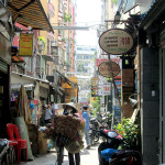 Small alley in Pham Ngu Lao with hotels and restaurants.