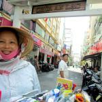 Street peddler in Pham Ngu Lao, Ho Chi Minh City.