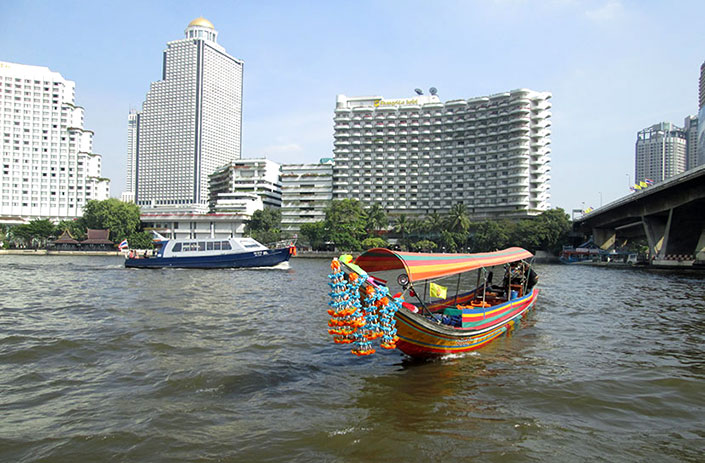 Traveling by ferry on the Chao Phraya River, Bangkok.